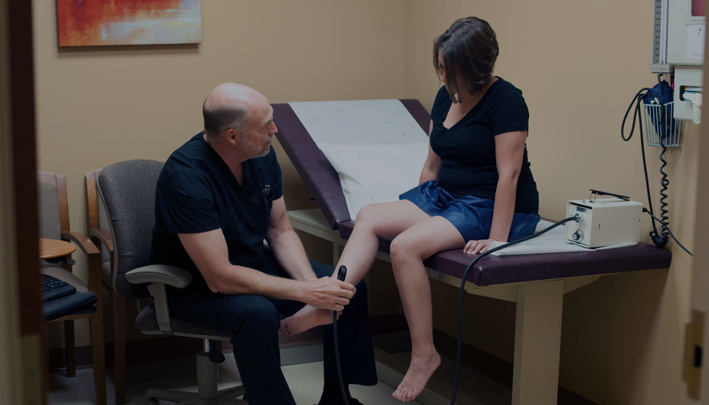 Dr. McNeill working on a patient with leg veins