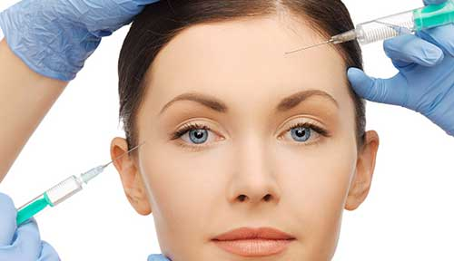 Woman getting dermal fillers from doctors